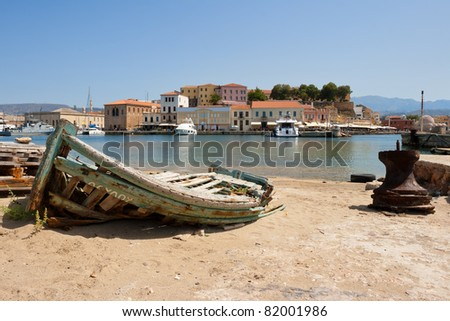 Old wrecked boat in harbor of Chania. Crete, Greece - stock photo