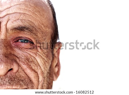 Old wrinkled man against white background - stock photo