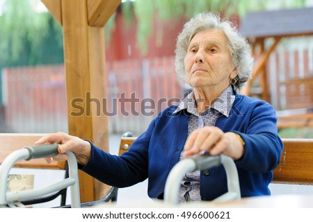 Old wrinkled women hand hold walker