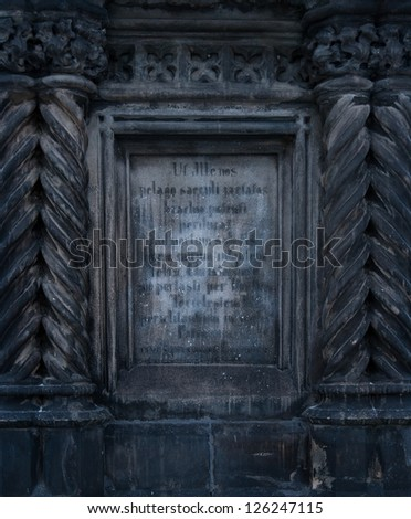 Old writings on stone wall - stock photo