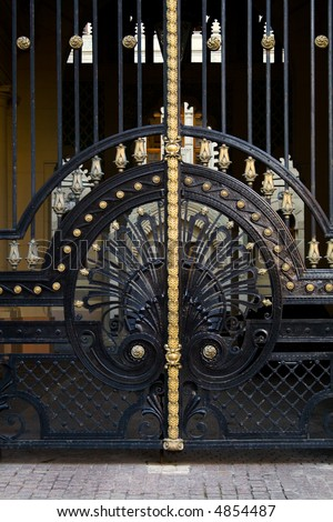 old wrought iron gate - stock photo