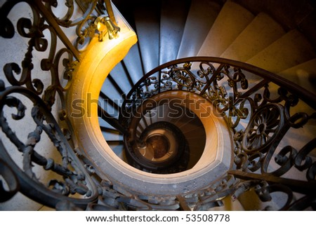 Old wrought spiral staircase in Versailles Chateau. France Shallow DOF - stock photo