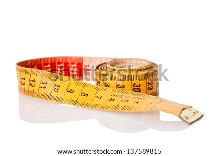 old yellow and red measure tape rolled - stock photo