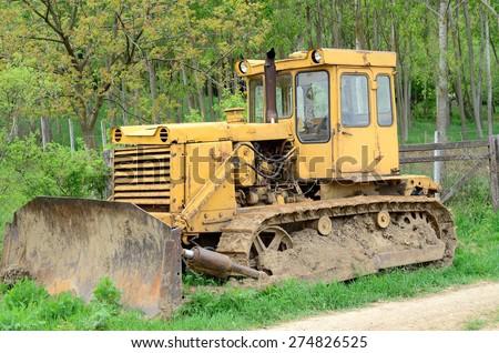 Old yellow bulldozer - stock photo
