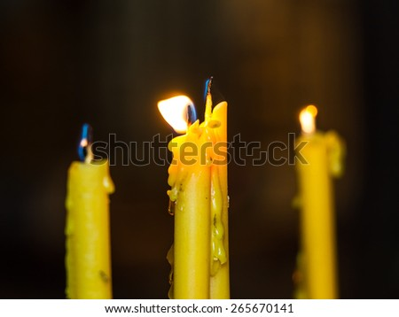 old yellow candle - stock photo