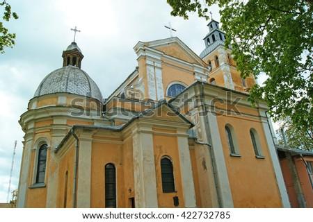 Old yellow Catholic church in the village of Svir, Belarus  - stock photo