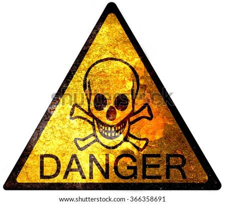 old yellow danger sign - skull - stock photo