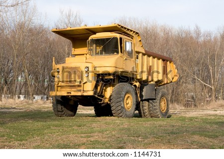 old yellow dump truck outside