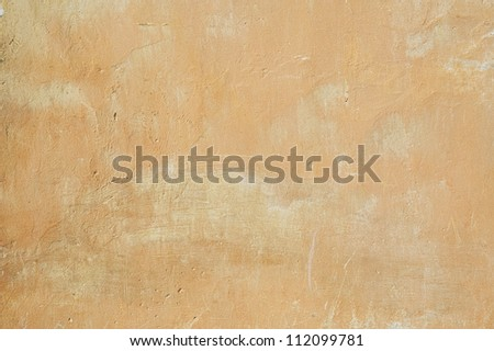 Old  yellow  stucco wall texture background - stock photo