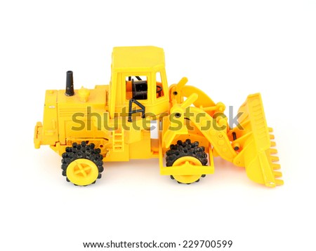 Old yellow toy tractor isolated on white background