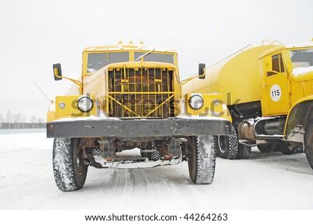 old yellow trucks - stock photo