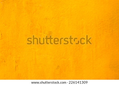 old yellow wall for background - stock photo