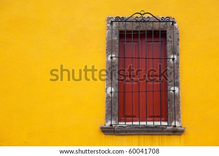 Old yellow window in old town. Mexico - stock photo