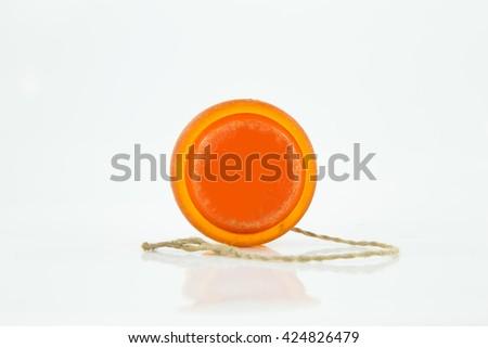 old yoyo orange isorated on white background - stock photo