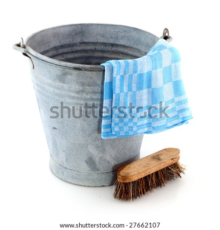 Old zinc bucket with cleaning brush and cloth - stock photo