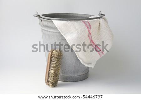 Old zinc bucket with floor cloth and brush - stock photo