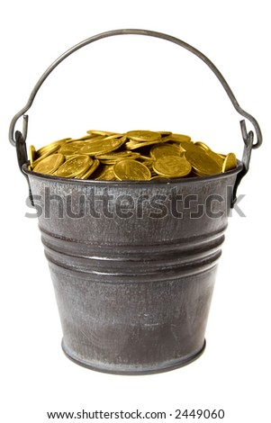 Old zinc bucket with golden coins. Isolated. - stock photo