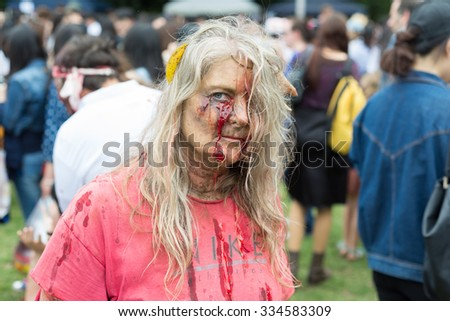 Old zombie lady at Sydney Zombie Walk in Sydney, AU, 31st October, 2015. Zombie Walk is an annual event where thousands of people get involved to raise awareness for Australia's Brain Foundation. - stock photo