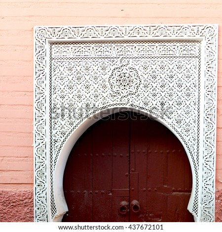 olddoor in morocco  africa ancien and wall ornate brown - stock photo