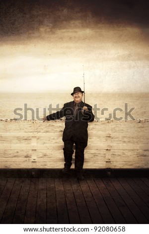 Olden Day Seaman Smiling On The End Of A Pier While Holding Fishing Rod In A  Photograph Containing Artifacts, Stains, Noise And Distortion - stock photo