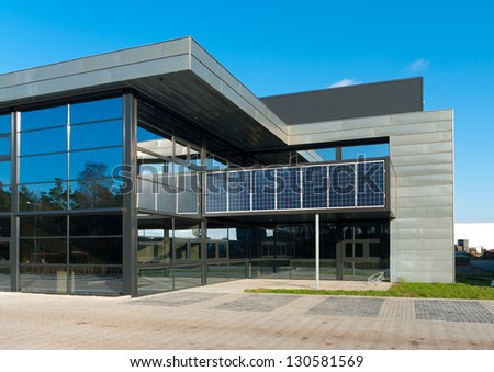 OLDENZAAL, NETHERLANDS - DEC12: Office with solar panels on december 12, 2011 in Oldenzaal, Netherlands. In 2013 government subsidizes 4 billion euros for companies who invest in sustainable energy - stock photo