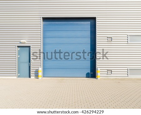OLDENZAAL, NETHERLANDS - OCTOBER 31, 2015: Closeup of small warehouse roller door