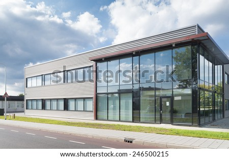 OLDENZAAL, NETHERLANDS - SEPTEMBER 27, 2014: Exterior of a newly build modern office building - stock photo
