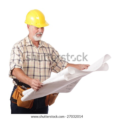 Older architect builder reading blueprints at the site - stock photo