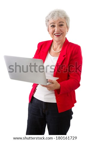 Older business woman in red with laptop - isolated on white.
