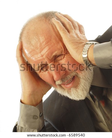 Older businessman in pain at the office; isolated on white - stock photo