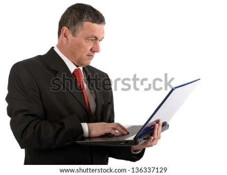 Older businessman with a laptop isolated on white background