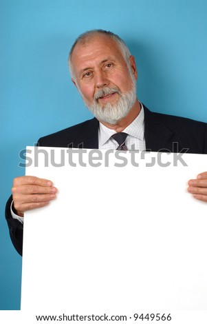 Older businessman with copy space board ready for text