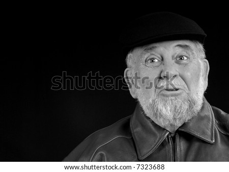 Older Caucasian Male with Beard and Very Expressive Face - stock photo
