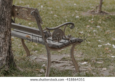 older chair in the park - stock photo