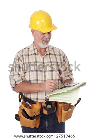 Older construction worker writing out an estimate; isolated on white - stock photo