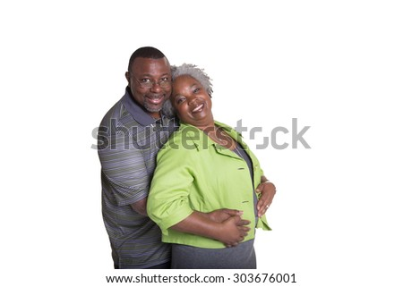 Older couple embracing isolated on white - stock photo