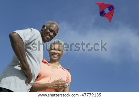 Older Couple Flying Kite - stock photo