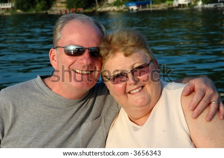 older couple hugging - stock photo