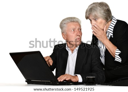 older couple in the workplace on a white background - stock photo