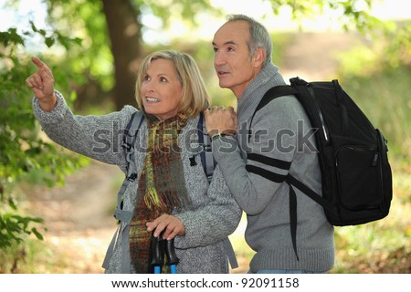 older couple in woods - stock photo