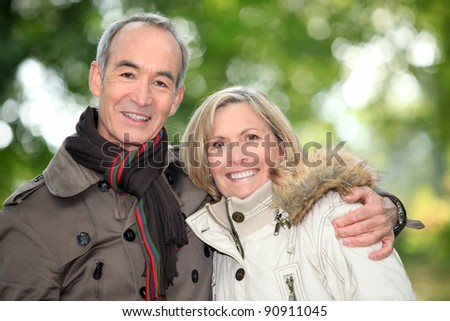 Older couple  on an autumnal walk - stock photo