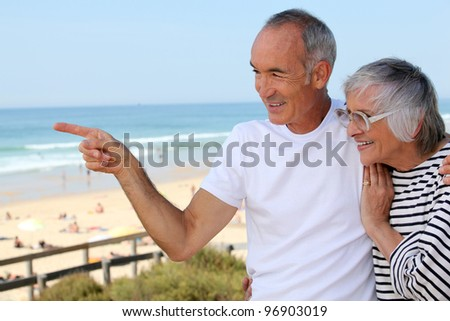Older couple on the prom - stock photo