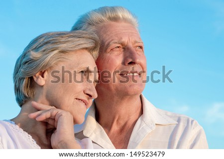 older couple relaxing on a sunny day together - stock photo