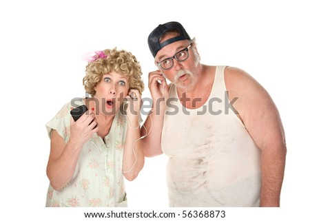Older couple tuning in to a controversial program - stock photo