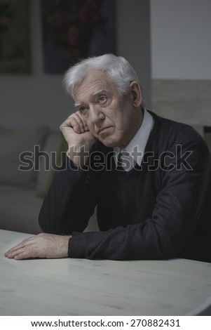 Older depressed man thinking about his past - stock photo