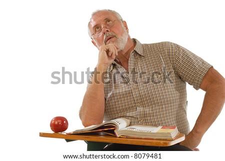 Older gentleman back at school during his retirement years - stock photo