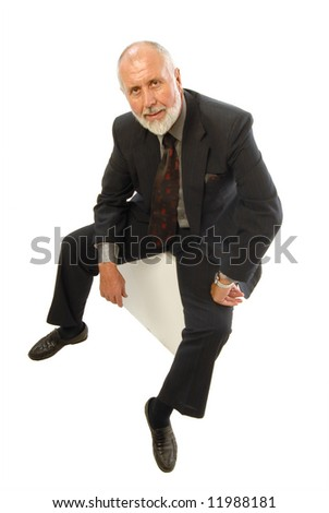 Older gentleman in a business suit relaxing and smiling