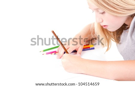 Older girl or teen drawing with colored pencils - stock photo
