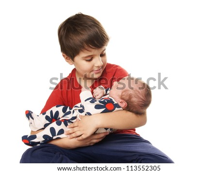 Older happy brother holding cute newborn baby sister isolated on white background - stock photo