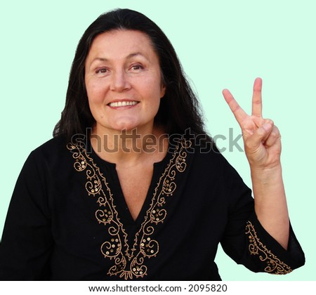 Older hippie with a peace sign - stock photo